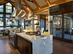 - Kitchen Pictures From HGTV Dream Home 2014 **Love the dark lower cabinets as well as the outdoor dining area and grilling station that are easily accessible via a sliding glass door