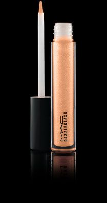 "Mac's ""Dazzleglass Lipglass"" ($20.00)! This lip gloss is another favorite of mine. If you want to add a little pop to your casual look, this lip gloss is a perfect match. I use the neutral, softer- looking color ""Moth to Flame""."