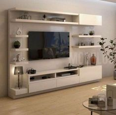 These ideas demonstrate how to create comfortable seating areas and very attractive and functional living room designs. Modern living rooms with the TV feature family friendly atmosphere and offer wonderful spaces for entertaining or rest. Living Room Wall Units, Living Room Tv Unit Designs, Home Living Room, Tv Living Rooms, Tv Wall Unit Designs, Tv Stand Ideas For Living Room, Living Room Decor Tv, Modern Tv Unit Designs, Living Room Cabinets
