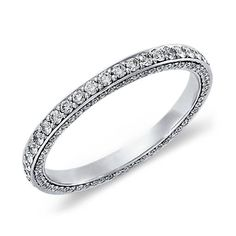 Delicate in essence, this diamond eternity ring in white gold showcases a full circle and three rows of petite micropavé-set diamonds, beautiful as a wedding or anniversary ring.