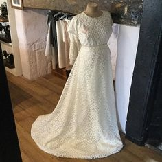 Beautiful White Ophelia wedding dress Made from a high quality embroidered lace and layers of georgette underskirt. No boning Princess seam front and back detail Concealed Zip back with button and loop up detail. Lined bodice Beaded trim waist detail Skirt has a Lace overlay with