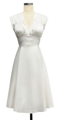 If I had my wedding to do over again, this would be my dress. Check out the gorgeous button details on the back.