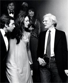 Ricky von Opel, Marisa Berenson and Andy Warhol   New York, dicembre 1975  © Getty Images