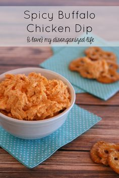 Spicy Buffalo Chicken Dip is packed with shredded chicken and has the perfect kick for your next gathering!