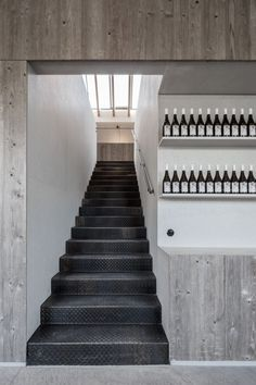 A flight of black metal stairs can then be used to reach the casual meeting area that sits up top. Bar Interior, Interior Stairs, Interior Design, Industrial Architecture, Interior Architecture, Copenhagen Hotel, Metal Stairs, Brick Facade, Ground Floor Plan