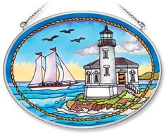 Amia Hand Painted Glass Suncatcher with Coquille River Lighthouse Design, 5-1/4-Inch by 7-Inch Oval by Amia. $19.00. Comes boxed, makes for a great gift. Includes chain. Handpainted glass. Amia glass is a top selling line of handpainted glass decor. Known for tying in rich colors and excellent designs, Amia has a full line of handpainted glass pieces to satisfy your decor needs. Items in the line range from suncatchers, window decor panels, vases, votives and much more.