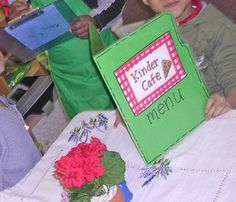 Setting up a table as a restaurant was also a popular choice. The kids would practice writing when they took orders. They also liked to make their own menus.