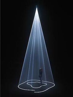 Anthony McCall. Coupling, 2009  video projector, computer, QuickTime Movie file, haze machine.
