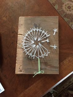 My dandelion string art. Easy to do a little time consuming putting all the nails in.