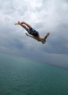 Summer cliff diving