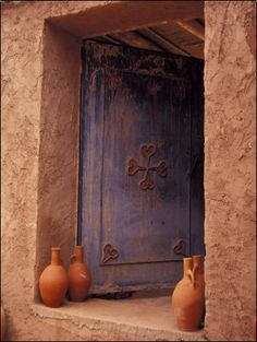 Berber Village Doorway, Morocco. Photo by   Darrell Gulin.  Nouri is 100% Berber, he had a water jug just like these. Wish he'd brought them with him here. :(
