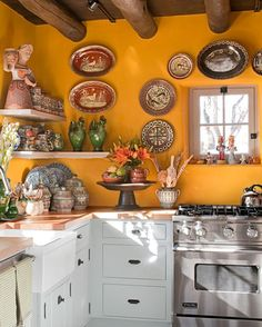 10 Yellow Kitchens That'll Make You So Happy. 10 Yellow Kitchens Decor Ideas - Kitchens with Yellow Walls. You'll obsess over these sunny spaces. Mexican Kitchen Decor, Kitchen Decor Themes, Country Kitchen, Home Decor, Mexican Style Decor, Mexican Kitchens, Happy Kitchen, Yellow Kitchen Walls, Yellow Kitchens