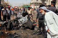 BASRA BOMBING: A man looked as security force members inspected the site of a deadly car bombing in Basra, Iraq, Sunday. A series of apparently coordinated bombings and a shooting killed at least 51 people and wounded dozens across Iraq. (Nabil al-Jurani/Associated Press)