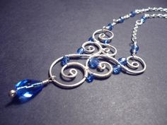Spiral+pendant+royale+blue+and+silver++wire+jewelry+by+Juditta,+$21.00