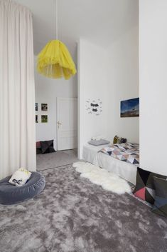 Apartment H+M by destilat: Scandinvian-inspired kid's bedroom with gray and beige accents | NONAGON.style