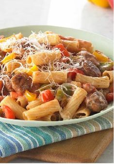 Sausage with Peppers and Pasta – You'll bring the flavors of a sausage and peppers sandwich from an Italian street fair to your dinner table with this pasta recipe.