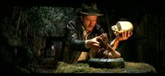Indiana Jones (Harrison Ford) snatching up the Chachapoyan Fertility Idol -- Raiders of the Lost Ark