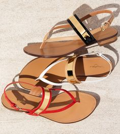 Love how the sleek goldtone hardware of these summer sandals glimmer in the sun.