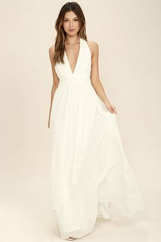 Lulus Exclusive! You'll get looks everywhere you go in the Stop and Stare Ivory Halter Maxi Dress! Lightweight chiffon shapes the plunging halter bodice with an open back, and tying neckline. A banded waist sits atop a full, wrapping maxi skirt. Hidden back zipper/clasp.