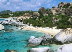 Remarkable Beach at Virgin Gorda. You must hike though a beautiful water filled rock cave to reach the beach