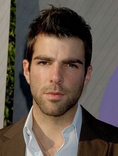 ZACHARY QUINTO. 1977. b-r- Pittsburgh. Educ: CarnMel 1999. bla-lbr. 6-2. Bio: Actor. TV: 24 (2003); Heroes (2006-10-Sylar); SoNoTORious (2006); American Horror Story (2011-12). Film: Star Trek (2009, 2013-Spock). Com: vmasc; nice eyes,sexy. 10.9.9. Openly gay: w/ Jonathan Groff fr 2012.