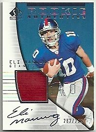 SportsCollectorsDaily.com: Eli Manning Rookie Cards Smothered by Hungry Bidders [Article]