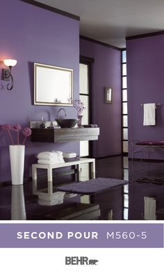 Sit back, relax, and let the deep purple hue of Second Pour by Behr Paint soak in. Adding a luxe style to this master bathroom, this bold wall color is the perfect way to take your DIY home makeover project to the next level. Click below for full color details to learn more.