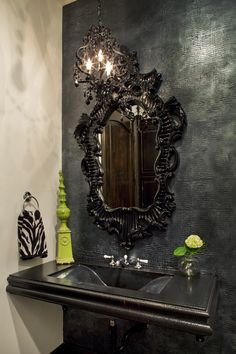 """Powder Room.  Textured black faux alligator skin wall paper. Black on Black on Black. Classic! By Design Studio, 2010.""  I just love the mirror!"