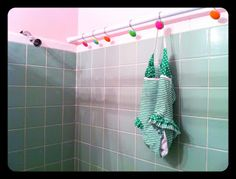 """""""The Wet Wall"""" Have wet swim suits, wet cycling bibs, hanging beach towels?  Create a space for drip-drying. Why didn't I think of THIS before?"""