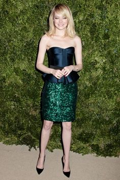 Emma Stone wore a strapless peplum top and emerald sequin pencil skirt, both by Burberry, with Christian Louboutin heels. (CFDA/Vogue Fashion Fund Awards 2012)