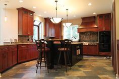 Rustic Craftsman Cherry Kitchen with Contrasting Espresso Island in Bel Air, MD. Madison Cherry Wood door with a Washington Cherry Stain and a Sable Glaze. Cherry Kitchen, Refacing Kitchen Cabinets, Before After Kitchen, Wood Doors, Cherry Stain, Kitchen, Custom Kitchen Cabinets, Home Decor, Cherry Wood
