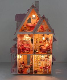 Promotion Wooden Dollhouse Miniature Foreign Style House Villa With 6 Lights DIY Doll House. $39.99, via Etsy.