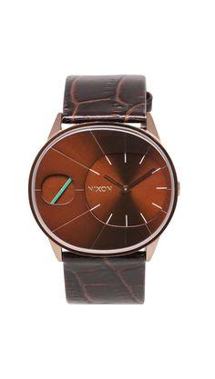 Nixon- love the wood-like look. Love this Nixon Watch.