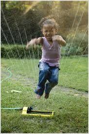Running through the sprinkler in the summer.