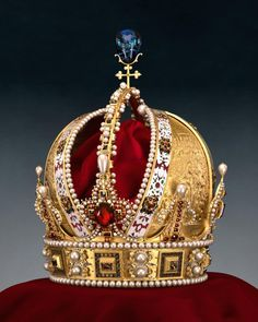 Austrian Imperial Crown. The Crown of Rudolf II, later Crown of the Austrian Empire, (made by Jan Vermeyen in Prague in 1602). It is made of pure gold, partially enamelled and studded with diamonds, rubies, spinel rubies, sapphires, pearls, and cushioned with velvet
