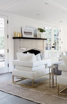 Bright brass, polished nickel and natural jute accents lend a mix of organic and modern appeal to this living room.