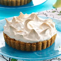 Key Lime Marshmallow Meringue Tarts Recipe -After spending time last winter in Key West, my husband and I became obsessed with Key lime pie. This is my downsized version of one we tried while spending time in that area. Marshmallow creme is the extra special touch. —Barbara Hahn, Park Hills, Missouri