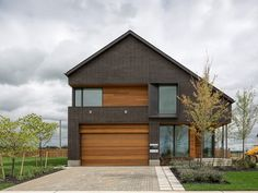 The Active House comes to Canada with a restrained modern design by Superkül | the house is oriented with the long roof slope and major glazing facing south to maximize the efficiency of the solar hot-water system and passive solar gain. The multitude of