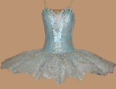crystal fountain fairy tutu in pale blue satin and net, silver/ lilac lace and decorated with irridescent beads and stones