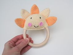 This Sun teething toy was been made specially for babies. It will be helpful when teething or simply playing. Different type of materials (wooden ring, crochet toy part) let's your baby to...