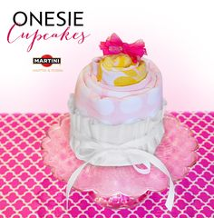 Shower your guest of honor with a sweet gift. Wrap a onesie up around a pair of brightly colored baby socks. Roll up in a receiving blanket. Place in a coffee filter and tie a ribbon around your #cupcake creation. Top it with a cute bow!