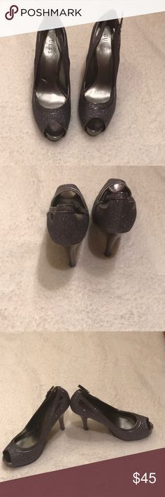 "Guess Silver Sparkle Peep-Toe Heels Guess silver sparkle peep-toe heels perfect for a special occasion!! Strap and buckle on the side. Heels are 5"", front platform is 1"". These are in great condition. Guess Shoes Heels"