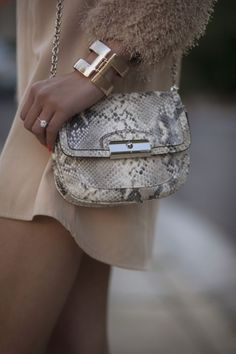 I have that coach snakeskin satchel... excited for that diamond ring I'll have to go with it one day... <3