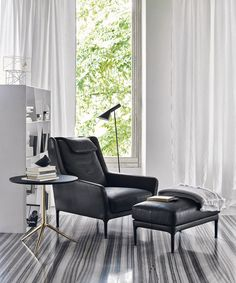Armchair designs: our top inspirations images   Édouard by B&B Italia.  Leather armchair and matching footstool; this is all you need to dive in your favourite gothic novel.