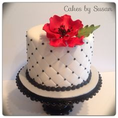 - Quilted sugar poppy wedding cake. This was going on top of a cupcake tier the bride made.