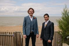 Groom wears dark casual trousers with a grey waist coat and jacket  | Photography by http://lmweddings.co.uk/