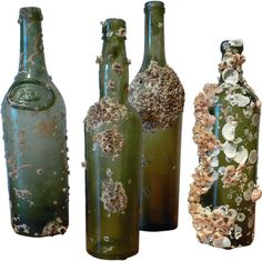 "1stdibs | Green Glass Shipwreck Bottles Antique glass spirit/alcohol bottles. Found in the South China Sea off the Java coast.  Some of the oldest specimens have elongated necks  and are called ""Dutch long-necks."" One with neck seal of lion, shield and marked ""BORDEAUX."""