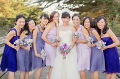 Bridesmaids wearing dresses in Iris, Plum