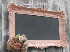 Take an old frame. Paint it your desired color and use chalkboard paint on the glass and voila!