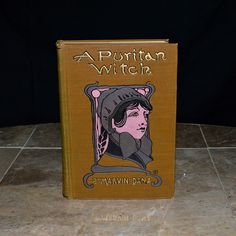 """1st edition copy of """"A Puritan Witch"""", printed in 1903. This copy is from the personal library of Governor Chase S. Osborn - an important and interesting historical figure. His book stamp is affixed to the inner cover. Osborn was a newspaper magnate and served a Governor of Michigan from 1911-1913. A world traveler, claiming to have visited every state in every country of the world and authoring several famous books about exotic places and his adventures…"""